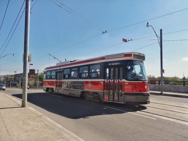 Old streetcar. Transportation Mode Of Transport Land Vehicle City Public Transportation Outdoors Tram Sky Clear Sky Cable Car Building Exterior Built Structure Architecture Day No People Streetcar StreetcarTO Ttcstreetcar Ttc Toronto Toronto Canada Ontario Canada Canada Coast To Coast