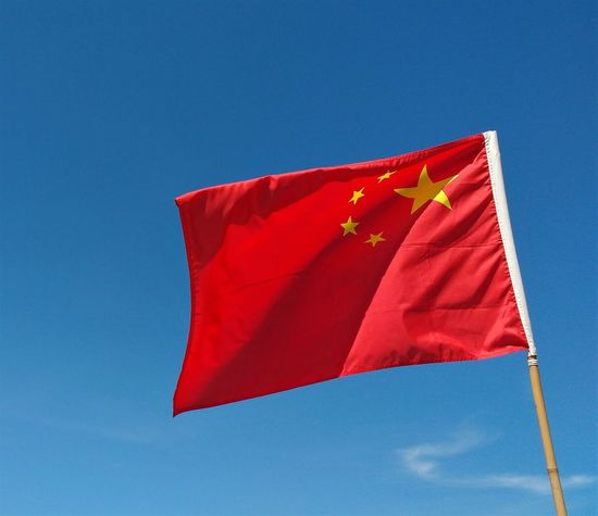 Flag of the People's Republic of China China Chinese Flag Blue Sky Day Flag Low Angle View National Flag Patriotism Red Stars