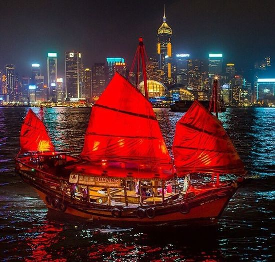 The splendor of HongKong harbor at dusk Nautical Vessel Transportation Night Architecture Boat Built Structure Mode Of Transport Building Exterior City Illuminated Waterfront Travel Water Travel Destinations Red Tourism River Urban Skyline Tower Skyscraper HongKong Travel Traveling