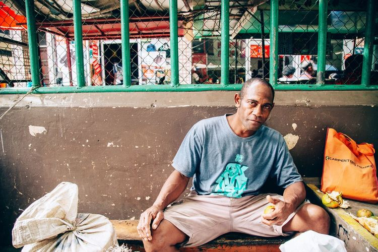 Fiji market Sitting One Person Mature Adult Portrait Looking At Camera Front View Casual Clothing Mature Men Day Real People Only Men One Man Only Men Full Length Smiling Outdoors Adults Only Adult People EyeEmNewHere