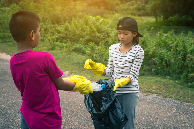 Volunteer Boys Child Childhood Garbage Garbage Collection Girls Group Of Children Holiday - Event Human Hand Nature Outdoors People Two People
