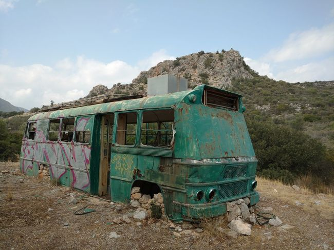 Abandoned Bad Condition Bus Cloud Cloud - Sky Damaged Day Deterioration Discarded Messy Mountain Obsolete Old Outdoors Poverty Rural Scene Rusty Sky Transportation Weathered