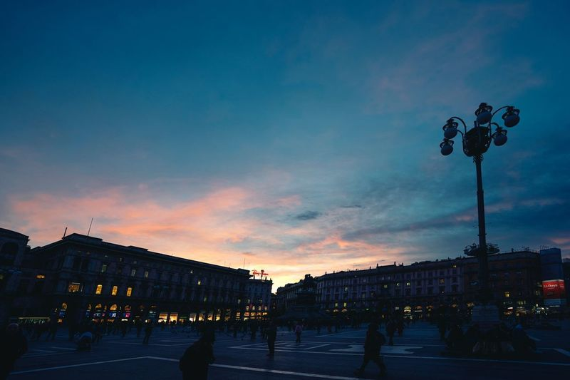 Sky Cloud - Sky Architecture Sunset Street Built Structure Building Exterior Lighting Equipment Silhouette Group Of People Building Plant Tree Outdoors Large Group Of People Light Nature Street Light City Dusk