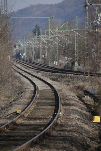 Railroad Tracks By Electricity Pylons