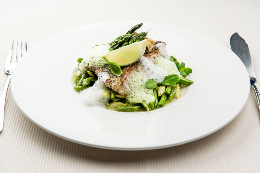Sea bass fillet with asparagus infused with sauce foam Cuisine Dinner Dinning Meal Time Sea Bass Seafood Table Setting Appetizing  Asparagus Close-up Delicacy Delicious Fish Fillet Food Main Course Milk Foam No People Nobody Plate Restaurant Restaurant Food Serving Dish Tasteful Tasty Vegetable