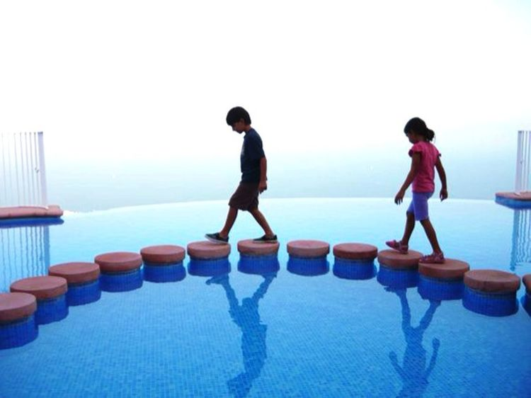Snapshots Of Life Blue Sky Water Children Pool Infinity Pool Chilling Edge Of The World Majorca, Spain People And Places
