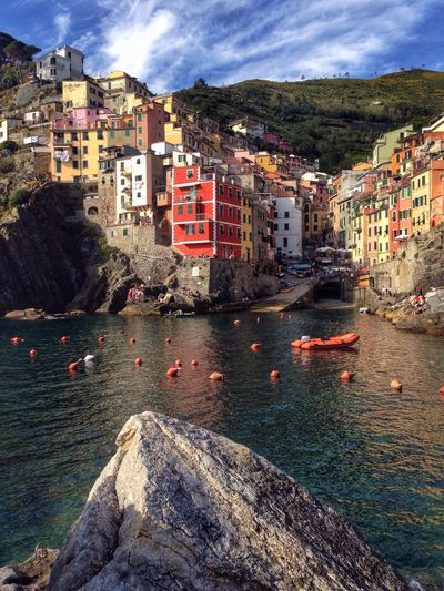 Riomaggiore, Cinque Terre, Italy Building Exterior Architecture Built Structure Nautical Vessel Outdoors Water Sky Waterfront Day No People Residential Building Sea Cloud - Sky Travel Destinations Moored City Riomaggiore Italy Cinque Terre