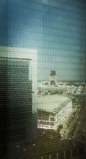 Digital composite image of modern building against blue sky