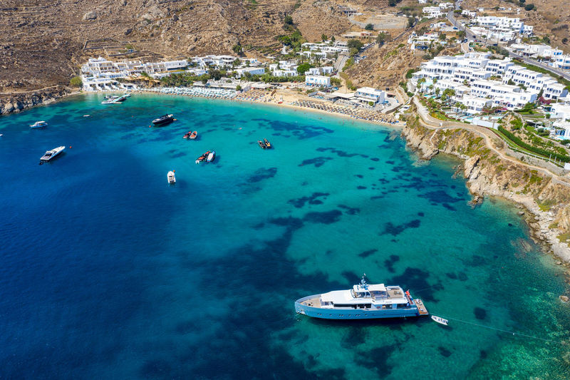 Aerial view of the popular Psarou beach on the island of Mykonos, Cyclades, Greece Celebrity Mediterranean  Aerial View Bay Beach Beauty In Nature Coastline Cyclades Day Expensive Greece High Angle View Island Luxury Mykonos Nautical Vessel Popular Psarou Sea Ship Travel Travel Destinations Turquoise Colored Water Yacht