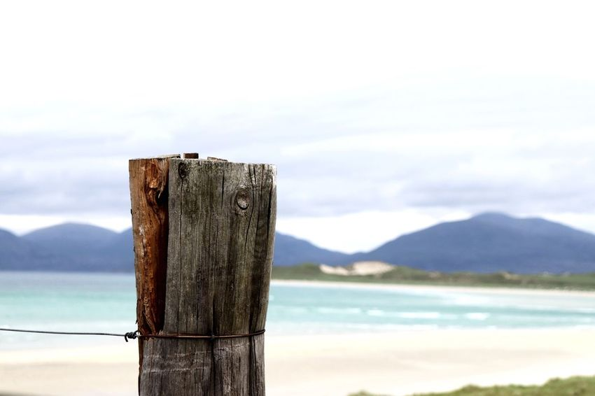 Scotland EyeEm Selects Water Sky Cloud - Sky Focus On Foreground Post Mountain No People Tranquility Day Nature Tranquil Scene Wood - Material Scenics - Nature Wooden Post Sea Beauty In Nature Outdoors Beach