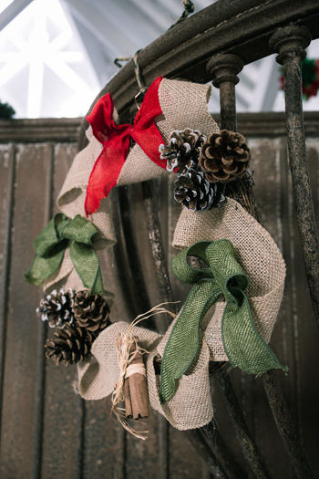 Close-up of christmas decoration hanging on wood