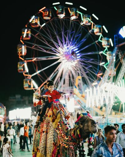 ride Fresh On Eyeem  Fresh On Market 2018 FreshonEyeem Camel Camel Riding India Indiapictures Indian Culture  Indianphotography City Crowd Illuminated Nightlife Women Men Arts Culture And Entertainment Celebration Excitement Traditional Festival Carnival Amusement Park Ride Carousel Ride Festival Carousel Horses