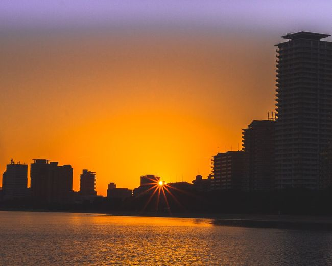 Sunrise. Sunset Sky Architecture Building Exterior Built Structure Orange Color City Water Building Nature No People Reflection Silhouette Urban Skyline Outdoors Sea Waterfront