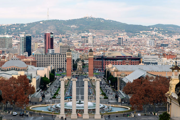 Montjuic fountain on Plaza de Espana in Barcelona, Spain catalonia Building Exterior City Architecture Built Structure Cityscape Sky Building Transportation High Angle View Mode Of Transportation Motor Vehicle Residential District Nature Car Day Crowded Land Vehicle City Life Cloud - Sky Outdoors Office Building Exterior Skyscraper Barcelona Montjuic