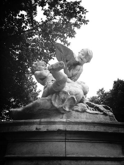 Since my fiance is away traveling for my birthday, my friend took me out to get me out of the house because I pretty much just hole up and watch tv while he's gone because life is pointless without him...anyway, I saw this statute of cherubs doing, I have no idea what. They always depict cherubs as somewhat mischievous. Have you ever noticed that? Düsseldorf The Explorer - 2014 EyeEm Awards EyeEm Bnw Statues Angels Wrestling Angels Statue German Germany German Statue Cupid Cupid Statue