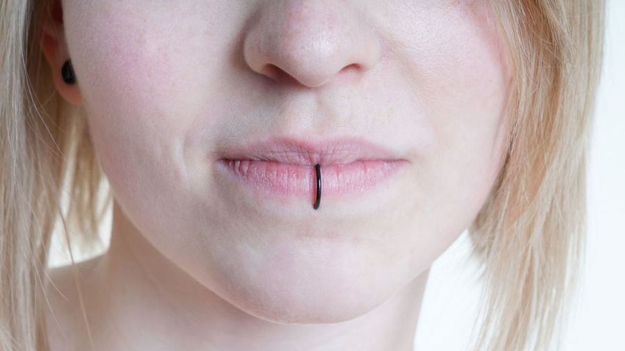 lip ring or vertical labret piercing Fashion Lips Piercing Woman Blond Hair Close-up Facial Piercings Girl Human Body Part Human Face Human Lips Jewelry Labret Lip Piercing  Lip Ring People Pierced Real People Trend Vertical Labret Women Young Adult