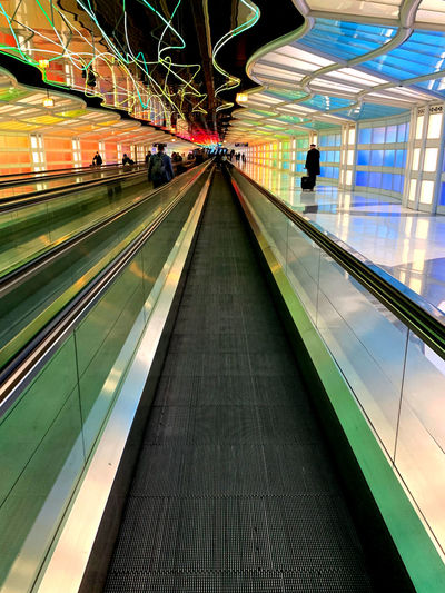 Architecture Transportation Illuminated Moving Walkway  Indoors  Motion Built Structure Modern Direction Men Travel The Way Forward Real People Group Of People Incidental People Connection Lifestyles Blurred Motion Mode Of Transportation Technology Diminishing Perspective