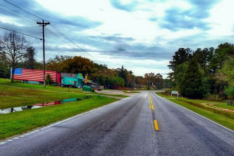 Roadside Americana -- Road American Flag America Sky Landscape HDR Autumn Trees Street Architecture Dramatic Sky Moody Sky Clouds And Sky Light And Shadow Reflection Countryside Rural Rurex Hdr_Collection Eye4photography  No People Building Nature Streetphotography The Street Photographer - 2016 EyeEm Awards