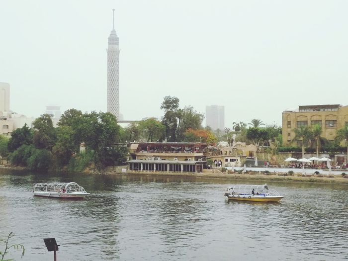 Nile cruise Cairo Tower Mopilephotgrpy Cruise Nile River Boats⛵️ Sky Tree Water Nautical Vessel City Clear Sky River Sky Architecture Building Exterior Built Structure Tower