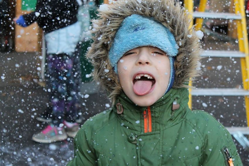 Child Fun Warm Clothing Sticking Out Tongue Human Tongue Happiness Children Only Mouth Open Enjoyment Winter Outdoors Childhood Excitement Christmas Playing Happy Time Snow Fair Portrait Colour Portrait