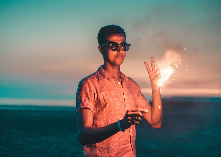 // sparkles & sunset // AMPt_community Enjoying The Sun Fun Happiness Sparkle Summertime Beach Casual Clothing Enjoying Life Fashion Flare Fresh Front View Glasses Horizon Over Water Land Leisure Activity Lifestyles Model Nature One Person Outdoors Real People Sea Shootermag Sky Sparkler Standing Summer Sunglasses Waist Up Water Young Adult Young Men The Portraitist - 2018 EyeEm Awards