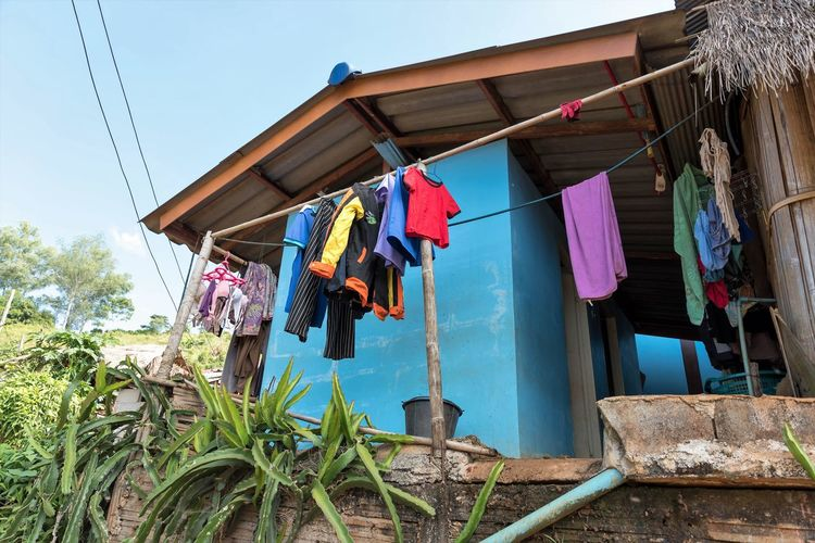 Hanging Clothing Drying Built Structure Building Exterior Architecture No People Clothesline Day Nature Laundry Plant Building Textile House Low Angle View Multi Colored Outdoors Cleaning Potted Plant Travel Destinations Travel Photography Thailand