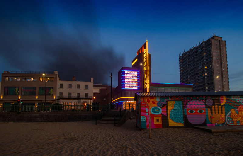 On Fire,Dreamland, Margate Seafront, Margate, Kent, England. Building Exterior Architecture Built Structure Sky Illuminated City Night Cloud - Sky Building Nature Land Sand No People Outdoors Beach Dusk Office Building Exterior Blue City Life Tower Skyscraper Seafront Vivid International Travel Destinations Tourism Garden Of England Getty Images EyeEM Beach Photography Dreamland Beach Hut Swimming Sunset Architecture Council Flats On Fire