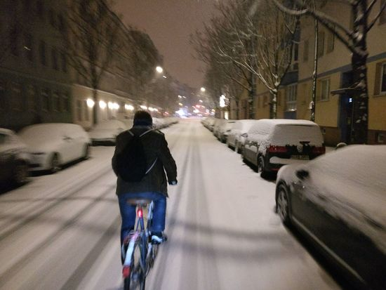 Bike Bicycle Slippery Winter Snow Winter Cold Temperature Night Rear View Illuminated City Weather Street Land Vehicle Mode Of Transport Snowing Transportation One Person Outdoors Motion