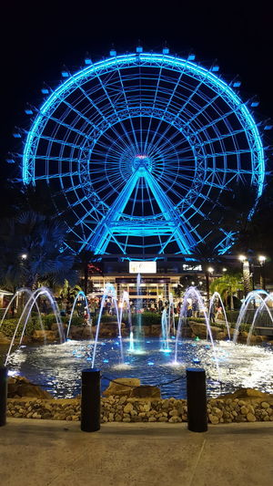 The Orlando do eye Orlando Orlando Florida Orlandoeye Theorlandoeye Blue Ferris Wheel Multi Colored Amusement Park Beach Sky No People Outdoors Water Day