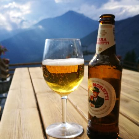 EyeEm Selects Alcohol Drink Bottle Drinking Glass Food And Drink Glass - Material Wine Wineglass Beer - Alcohol Refreshment Table Wine Bottle Close-up Beer Glass No People Frothy Drink Champagne Outdoors Day Sky Moretti Birramoretti Birra Birraitalianaoriginale #montagna
