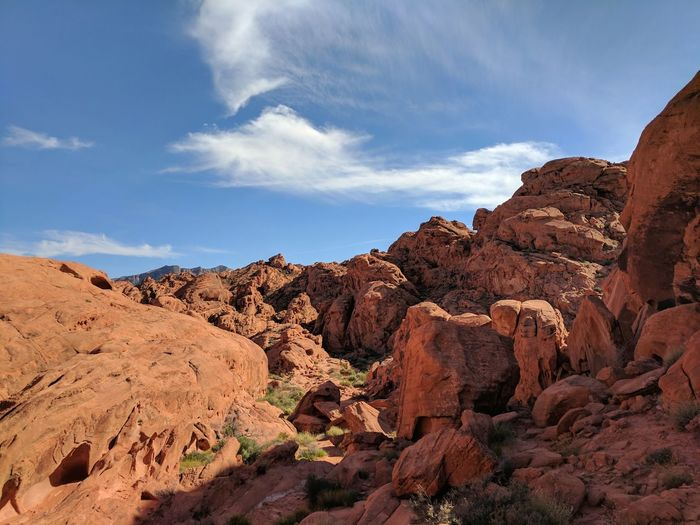 Landscape Rock - Object Travel Sunlight No People Outdoors Nature Sky Day Clouds Photographer Photography Fineart Nevada Scenics Vibrant Color Cloud - Sky Mountain Mountain Range Beautiful Valley Of Fire State Park Nature Beauty In Nature Blue Red