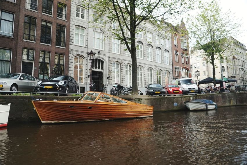 Sky Cityscape Day Tree Water Mode Of Transport Transportation Nautical Vessel Canal Architecture Building Exterior City Moored Car Built Structure Travel Destinations Outdoors No People Amsterdam