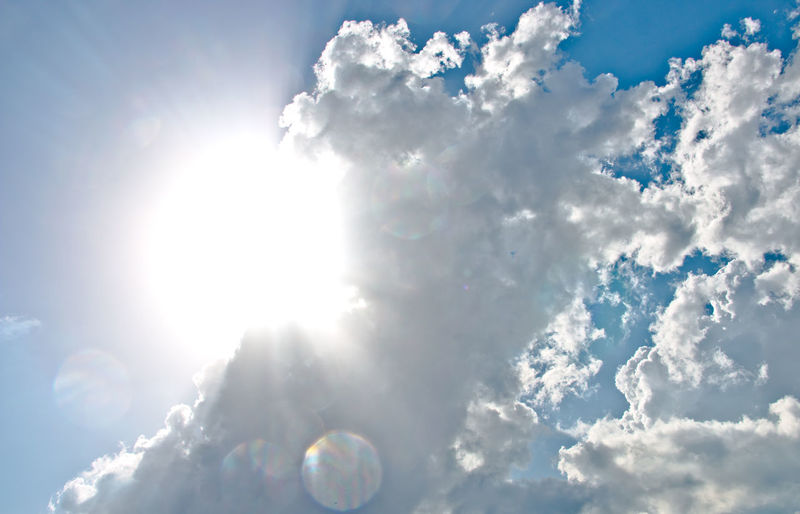 Beauty In Nature Blue Bright Brightly Lit Cloud - Sky Cloudscape Day Heaven Idyllic Lens Flare Low Angle View Meteorology Nature No People Outdoors Scenics - Nature Sky Softness Sun Sunbeam Sunlight Tranquil Scene Tranquility White Color Wind