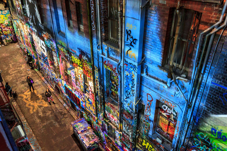 Hosier Lane graffiti from a height Graffiti Architecture Building Building Exterior Built Structure Choice City Consumerism Hosier Lane Illuminated Low Angle View Multi Colored Night No People Outdoors Retail  Store Street Tilt Transportation Wall Wall - Building Feature