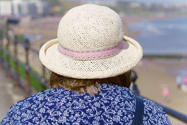 Rear view of woman wearing sun hat