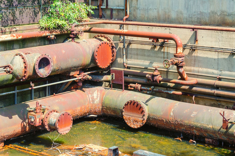 Metallurgical plant. Environmental problem of pollution. Emission of smoke blast furnace Abandoned Connection Damaged Day Decline Deterioration Industry Metal Mode Of Transportation Nature No People Obsolete Old Outdoors Pipe - Tube Pipeline Pollution Ruined Run-down Rusty Transportation Weathered