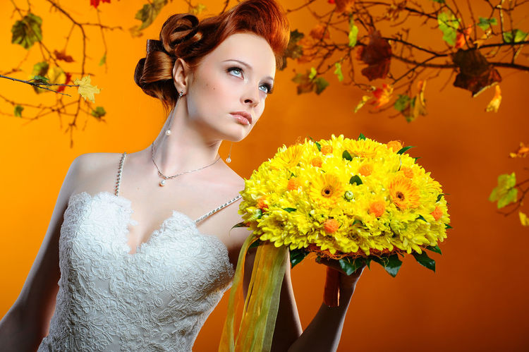 Beautiful bride with a bouquet of flowers. Autumn theme. Autumn Autumn Colors Autumn Leaves Fashion Makeup Romantic Twigs Wedding Beautiful Woman Beauty Bridal Bouquet Bride Bunch Of Flowers Fall Flowers Gerbera Daisy Glamour Hairstyle Leaves One Person Orange Color Studio Shot Wedding Dress Young Adult Young Women