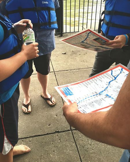 Prepping for adventure Activity Mapping Prepping Adventure Planning Real People Low Section Shadow Lifestyles Sunlight Leisure Activity Day Casual Clothing Men People Standing Togetherness Body Part Family City Childhood Positive Emotion Outdoors Child