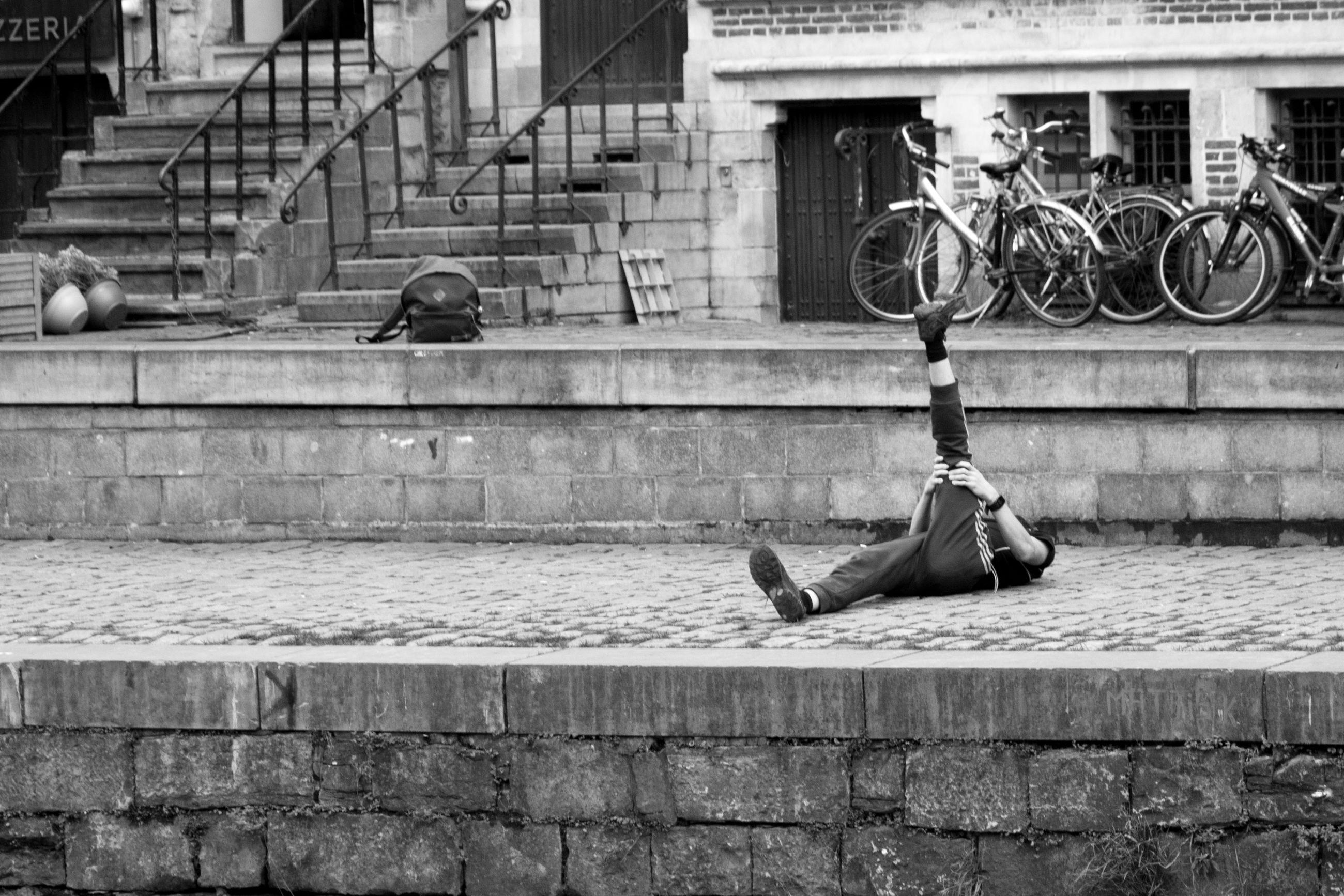 MAN CYCLING ON RETAINING WALL