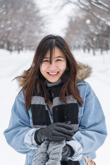 Portrait in snow ASIA Asian  Happy Japan Japan Photography Japanese  Adult Beautiful Woman Clothing Cold Temperature Day Emotion Front View Glove Hair Hairstyle Happiness Looking At Camera One Person Outdoors Portrait Real People Sapporo Scarf Smiling Snow Snowing Travel Destinations Waist Up Warm Clothing White Color Winter Women Young Adult