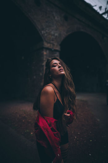 Arch Architecture Beautiful Woman Beauty Built Structure Clothing Hair Hairstyle Leisure Activity Lifestyles Long Hair One Person Real People Standing Three Quarter Length Women Young Adult Young Women