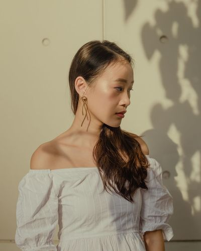 Hwee Light Light And Shadow Portrait Photography Portrait Of A Woman One Person Waist Up Hairstyle Standing Wall - Building Feature Hair Indoors  Looking Away Front View Portrait Young Women Women Shadow Contemplation