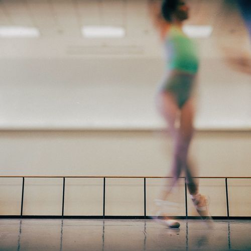 Ballerina Dancing In Studio