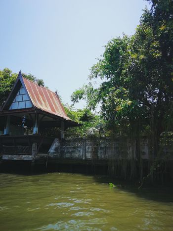 creek Water Tree Roof House Residential Building Sky Architecture Building Exterior Built Structure Lakeside