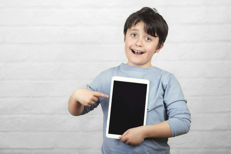 Child Smiling Technology Portrait Wireless Technology Communication Happiness Emotion Screen Tablet Digital Computer Student Happy Internet Happiness Concept Cyber Space Fun Funny Education Lifestyle Smile Tactile Connection