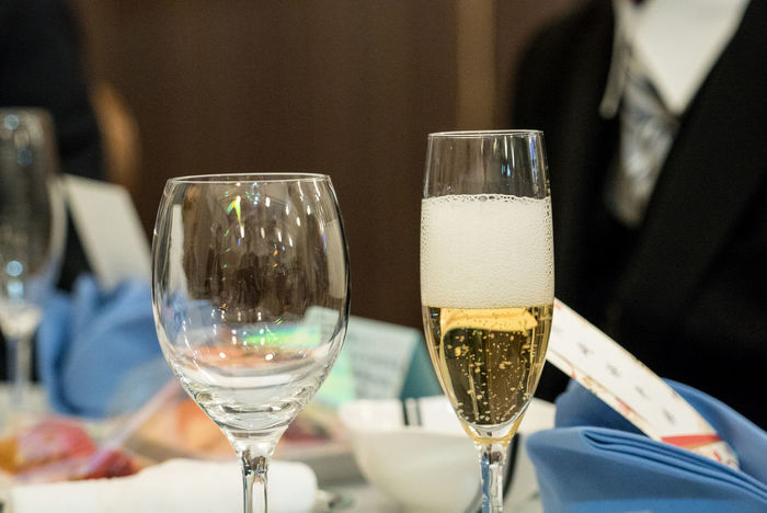 Celebration Wedding Alcohol Champagne Champagne Flute Cheers Close-up Drink Drinking Glass Focus On Foreground Food And Drink Freshness Glass Glass - Material Household Equipment Luxury No People Refreshment Restaurant Still Life Table Transparent White Wine Wine Wineglass