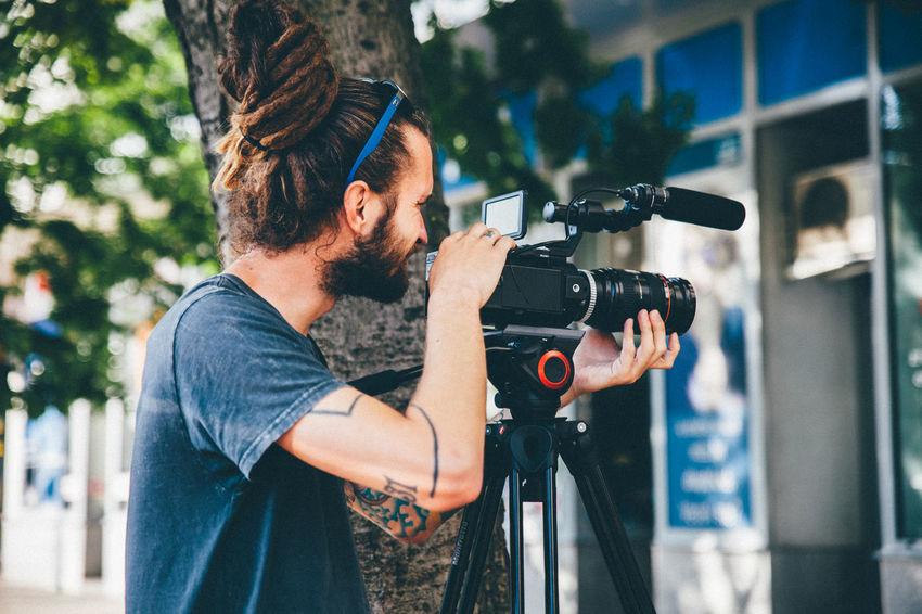 Camera CameraMan Filming Real People Working