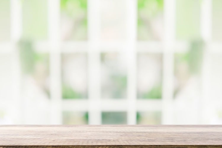 Close-up of window on wooden table