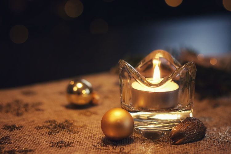 Christmas Christmas Bauble Candle Gold Colored Bauble Celebration Table No People Indoors  Close-up Christmas Decoration