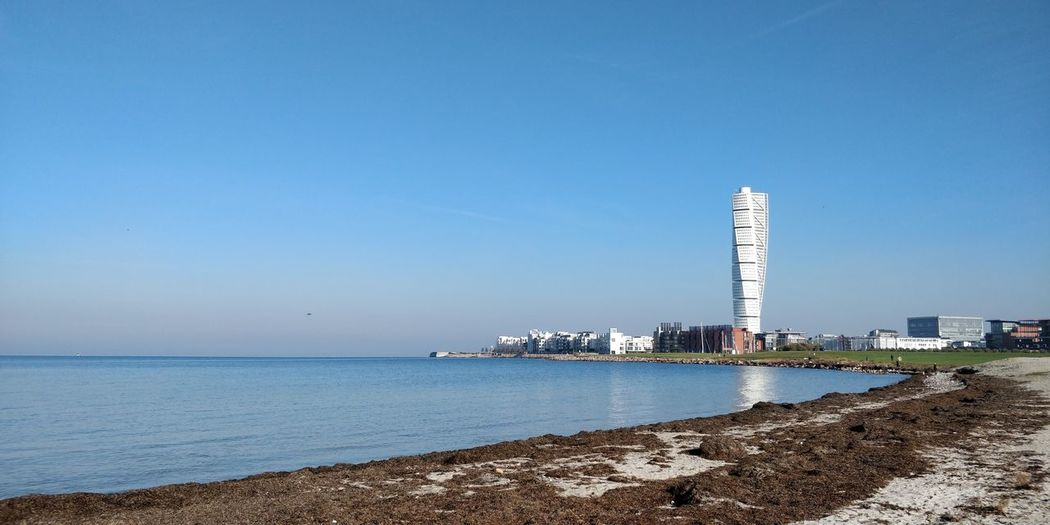 Sky Water Sea Architecture Copy Space Building Exterior Clear Sky Built Structure Land Nature Beach Day Tower Building Blue Horizon Scenics - Nature Horizon Over Water No People Outdoors Office Building Exterior Skyscraper Calatrava Turning Torso